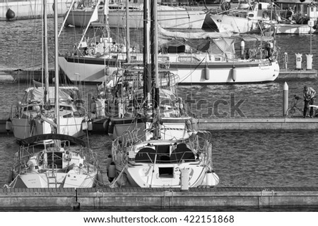 Italy, Sicily, Mediterranean sea, Marina di Ragusa; 17 May 2016, fishing boats and luxury yachts in the port - EDITORIAL