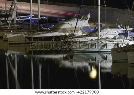 Italy, Sicily, Mediterranean sea, Marina di Ragusa; 18 May 2016, luxury yachts in the port at night - EDITORIAL