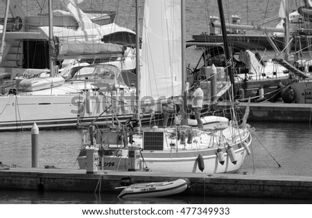 Italy, Sicily, Mediterranean sea, Marina di Ragusa; 2 September 2016, people on their sailing boat in the port - EDITORIAL