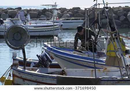 Italy, Sicily, Mediterranean sea, Punta Secca (Ragusa Province); 02 February 2016, fisherman working on his wooden fishing boat in the port - EDITORIAL