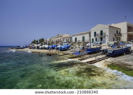 Italy, Sicily, Mediterranean sea, Sampieri (Ragusa Province), fishermen working ashore - stock photo