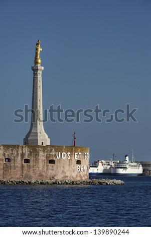 Italy, Sicily, Messina, view of the Madonna statue at the port entrance and some ferryboats - stock photo