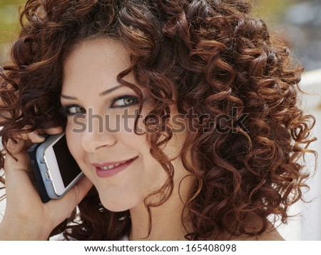 Italy, Sicily, portrait of a young girl on the cellular phone