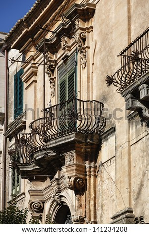 Italy, Sicily, Ragusa Ibla, Baroque building, old balcony with baroque ornaments.