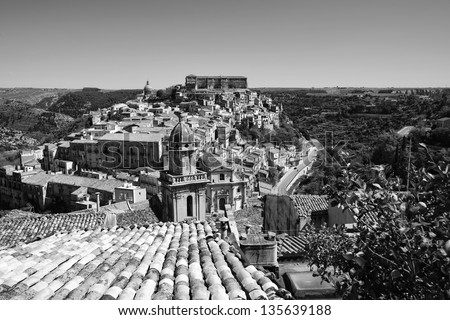 Italy, Sicily, Ragusa Ibla, view of the baroque town, S. Maria dell'Itria Baroque Church bell tower (18th century) and a lemon tree