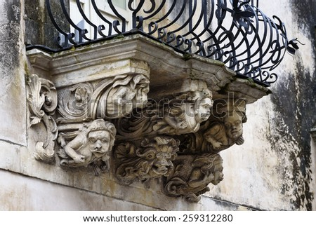 Italy, Sicily, Ragusa, Zacco Palace baroque facade and balcony (Unesco Monument), XVIII century. - stock photo
