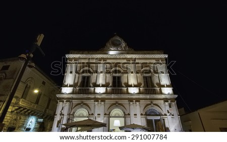 Italy, Sicily, Scicli (Ragusa Province), the baroque Busacca Palace facade at night - stock photo