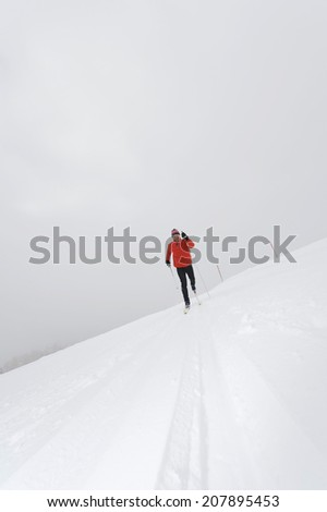 Italy, South Tyrol, man cross-country skiing