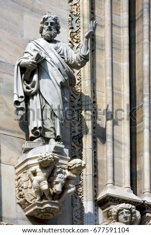 italy statue of a men in the front of the duomo  church in milan