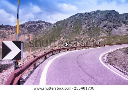 Italy, Stelvio National Park. Road to Stelvio Pass in Ortler Alps. Alpine landscape. Filtered style toned color. - stock photo