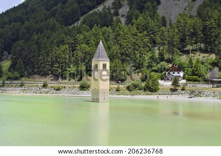 Italy, sunken church tower in Reschen Lake - Lago di Resia - in South Tyrol