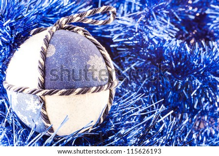 Italy. Traditional handmade Christmas balls made of white and blue fabric