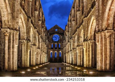 Italy, Tuscany region. Medieval San Galgano Abbey. - stock photo
