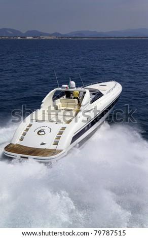 Italy, Tuscany, Viareggio, Tecnomar Madras 20 luxury yacht (20 meters), aerial view - stock photo