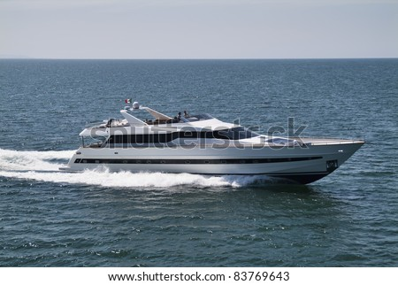 Italy, Tyrrhenian Sea, off the coast of Viareggio (Tuscany), Tecnomar 35 luxury yacht, aerial view - stock photo