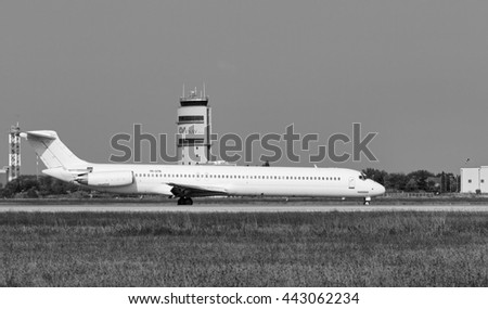 Italy, Venice; 14 September 2011, an airplane on the takeoff runway and the flight control tower - EDITORIAL