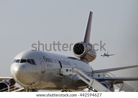 Italy, Venice, Venice International Airport; 14 September 2011, airplane on  the runway and another landing - EDITORIAL