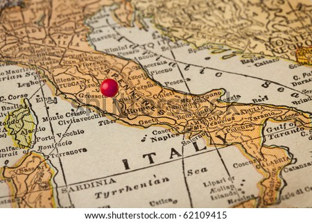 Italy vintage 1920s map (printed in 1926 - copyrights expired) with a red pushpin on Rome, selective focus - stock photo