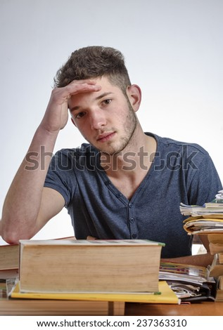 Italy, young student stressed by the school homework - stock photo