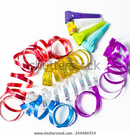 Item for party, colorful serpentine and blowers - stock photo