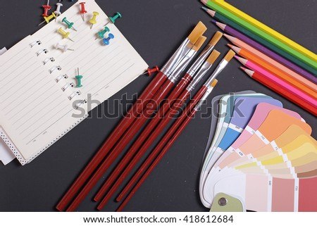 Items for children's creativity, black background