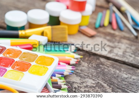 Items for children's creativity on a wooden background - stock photo