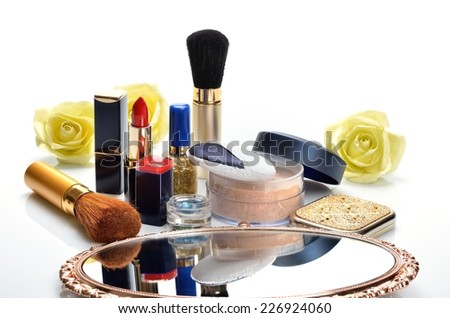 Items for women's makeup and cosmetics and a mirror - stock photo