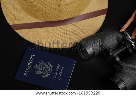 Items needed for adventure/Travel Necessities/Pith helmet passport and binoculars - stock photo