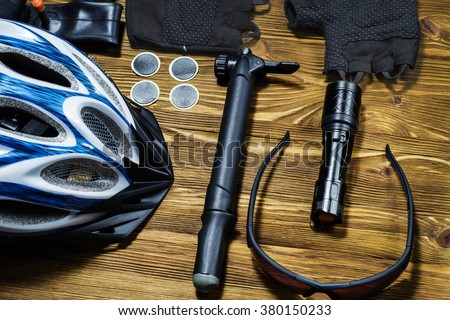 Items replacements and tools for a safe cycling: Helmet, gloves, glasses, pumps, patches, tire, chain tool.