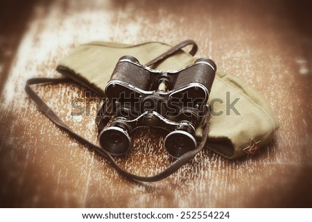 Items WWII: soldier field cap, military binoculars. Photos in retro style. May 9 Victory Day, the anniversary of the victory in the Great Patriotic War - 70 years - stock photo