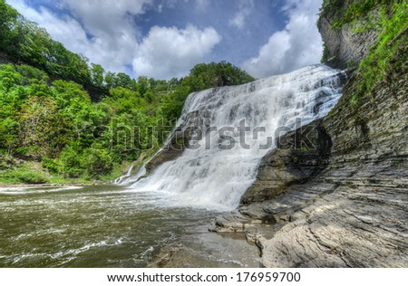 Ithaca Falls in the Finger Lakes region, Ithaca, New York. This is the last and largest of several waterfalls on Fall Creek. - stock photo