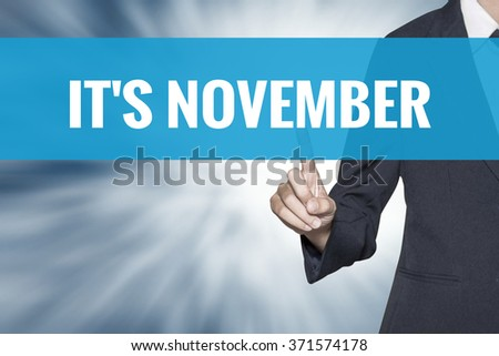 Its November word on virtual screen touch by business woman cyan sky tab - stock photo
