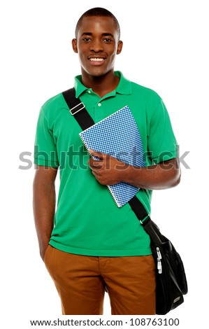 Its study time. Young african student carrying laptop bag and notebook