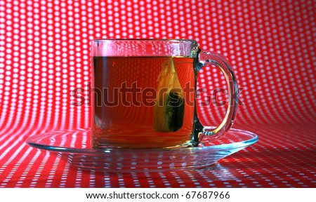 "Its ""Tea Time"".   Hot fresh brewed tea in a clear glass tea cup ready to be enjoyed any time of day or night or any season year round"