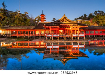 Itsukushima Shrine at night, Miyajima, Japan. - stock photo