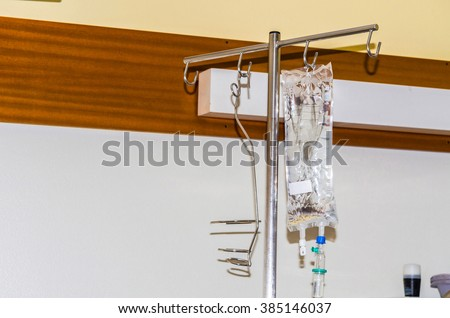 IV bag in a hospital filled with liquid attached to an infusion stand.