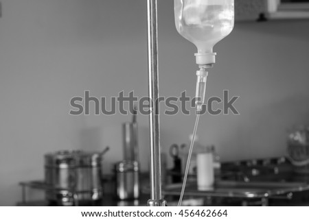 IV drip chamber, tubing, and bag of solution with copy space. - stock photo