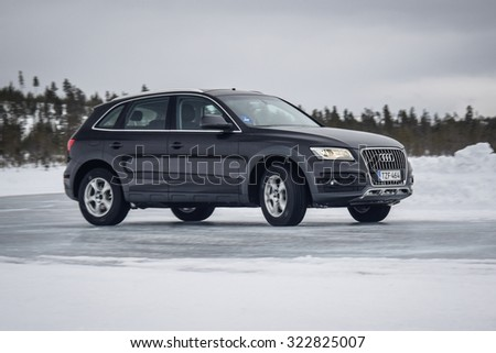 IVALO, FINLAND - February 15, 2015: Winter tire test is held at the proving ground. Test-driver performs ice handling test to determine the tire which provides the best grip on ice.
