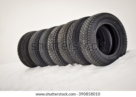 IVALO, FINLAND - January 28, 2016: Winter tire test is held at the proving ground. Seven various SUV winter non studdable tires tires are placed on snow. Snowy background. No wheel rims. - stock photo