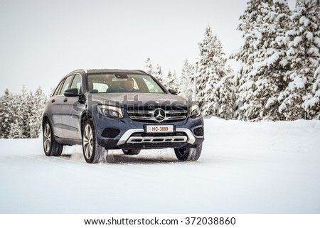 IVALO, FINLAND - January 28, 2016: Winter tire test is held at the proving ground. Test-driver performs a handling test on Mercedes-Benz GLC to determine the tire which provides the best grip on snow.