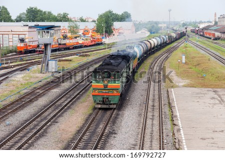 IVANOVO, RUSSIA - JUNE 29, 2013: View of railway station in city Ivanovo in summertime. Trains of the Russian Railways company (RZhD)