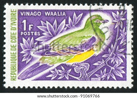 IVORY COAST CIRCA 1966: A stamp printed by Ivory Coast, shows Bruceâ??s green pigeon, circa 1966