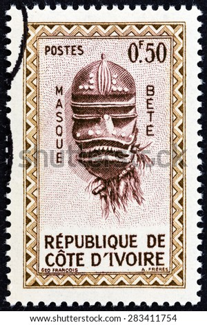 """IVORY COAST - CIRCA 1960: A stamp printed in Ivory Coast from the """"Native Masks """" issue shows Bete Mask, circa 1960.  - stock photo"""