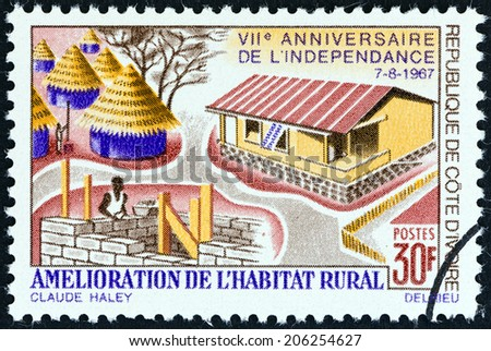 IVORY COAST - CIRCA 1967: A stamp printed in Ivory Coast issued for the 7th anniversary of Independence shows improvement of Rural Housing , circa 1967.