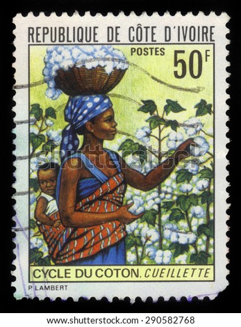 Ivory Coast  - CIRCA 1974: a stamp printed in the Ivory Coast shows picking cotton, circa 1974 - stock photo
