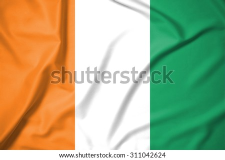 Ivory Coast flag on soft and smooth silk texture  - stock photo