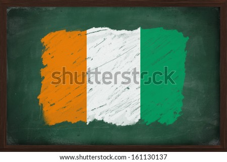 Ivory coast flag painted with color chalk on old blackboard
