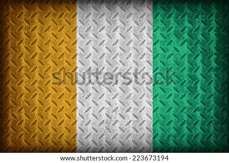 Ivory Coast or Cote D'Ivoire flag pattern on the diamond metal plate texture ,vintage style - stock photo