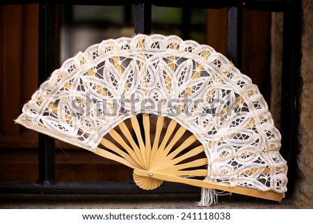 Ivory lace Spanish folding fan in Santillana del Mar in Cantabria, Spain - stock photo