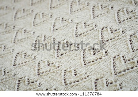 Ivory woolen hand-knit baby plaid with hearts - stock photo